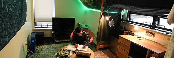A Clarkson undergraduate student studies in his residence hall room on campus