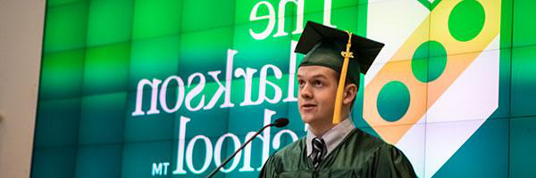 An undergraduate student in The Clarkson School addresses the audience at graduation.