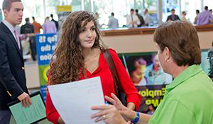 Student talking to employers at the career fair